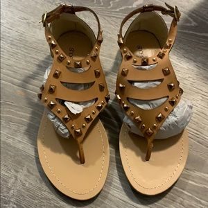 Never worn sandals for sale